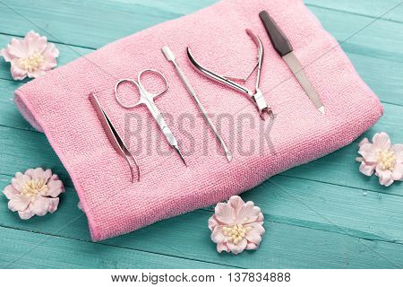 tool for manicure on pink towel. studio shot