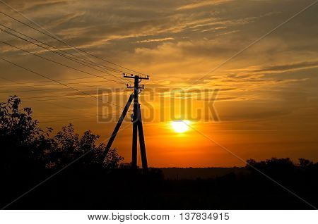 electric pole on the background of sunset