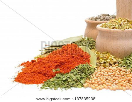 Composition with different spices and herbs: pepper, mustard seeds, powder paprika, bay leaf, dill, parsley, lovage, oregano, basil, sage