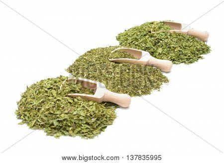 Dried dill, parsley and lovage on white background