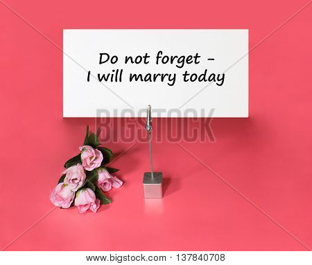 A note holder with a roses and a card with the text - do not forget - I will marry today