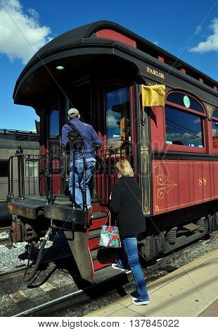 Strasburg Pennsylvania - October 16 2015: Passengers board a classic wooden Parlor Car for a ride on the renowned Strasburg Railroad