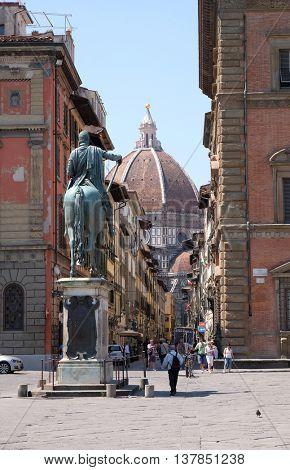 FLORENCE, ITALY - JUNE 05: Cattedrale di Santa Maria del Fiore. View from the Piazza della Santissima Annunziata and Giambologna's last statue, of Ferdinando I de' Medici, Florence, June 05, 2015
