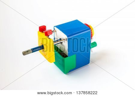 Closeup of the pencil sharpener with old pencil on white background