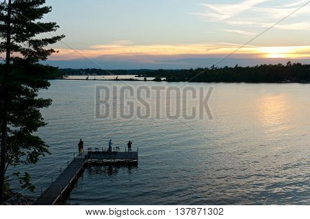 sunset scenic overlooking steamboat bay pier and shores of east gull lake in cass county minnesota outside brainerd baxter