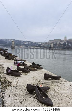 Shoes on the Danube Promenade in Budapest - memorial to the victims of the Holocaust poster