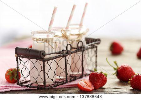 Strawberry Yogurt In Bottle On Wooden Table