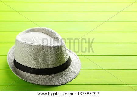 Pretty White Hat On A Green Wooden Table
