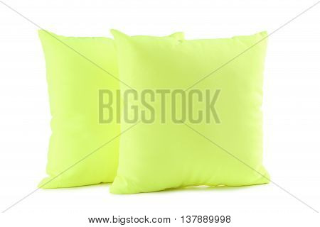 Green pillow isolated on a white, close up