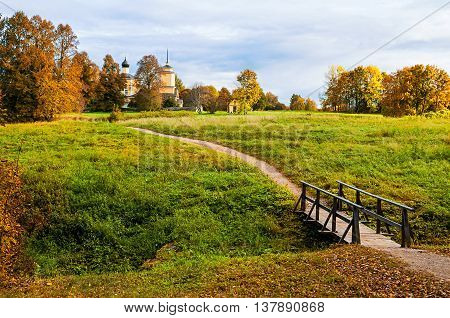 PUSHKINSKIYE GORY RUSSIA - SEPTEMBER 28 2013. Church of St. George on fortress of Voronich - autumn picturesque rural landscape