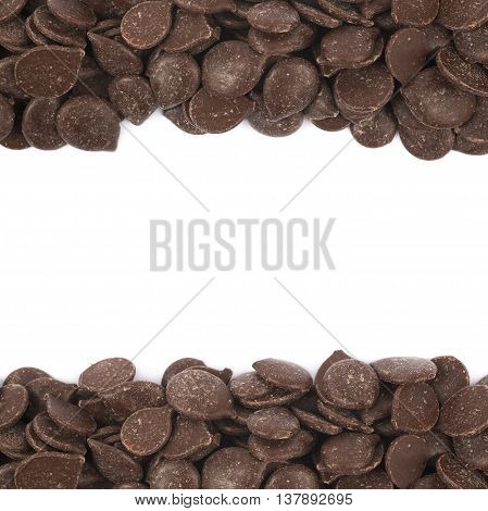 Copyspace background composition with the borders made of cooking chocolate teardrop shaped chips isolated over the white background