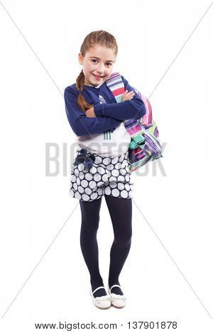 Full lenght portrait of a little student girl carrying backpack on white background