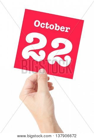 October 22 written on a card held by a hand