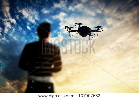 Man operating a drone at sunset. Aerial videography job. 3D rendering