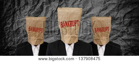 Group of businessman, brown paper bag on head with