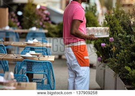 African american waiter during on the work in outdors city cafe