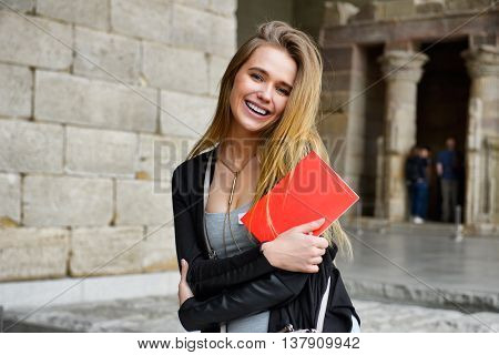 Happy tourist girl sightseeing city with map and guide book