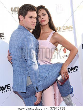 LOS ANGELES - JUN 29:  Adam Devine & Chloe Bridges arrives to the