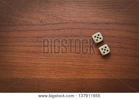 two dice number double 5 on the wooden table