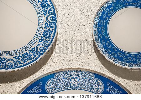 Porcelain white and blue chinaware on the white wall