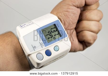 sphygmomanometer to measure blood pressure on hand.