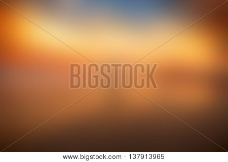 Colorful background of orange sunset sky and water