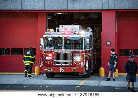 NEW YORK - OCT 20 2015: FDNY Ladder truck going for resque with firemen