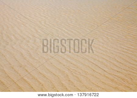 Closeup Of Sand Pattern Of A Beach In The Summer