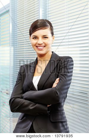 Image of formal businesswoman in suit on the background of jalousie