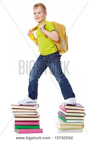 A boy with satchel walking on two heaps of books