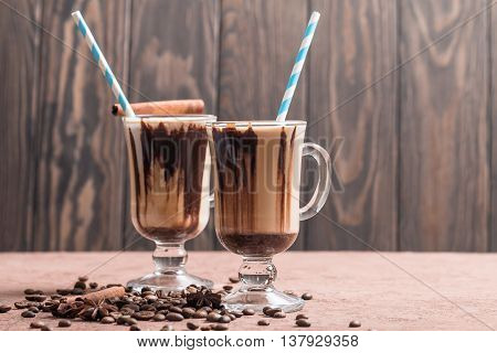 Ice coffee with milk on brown table