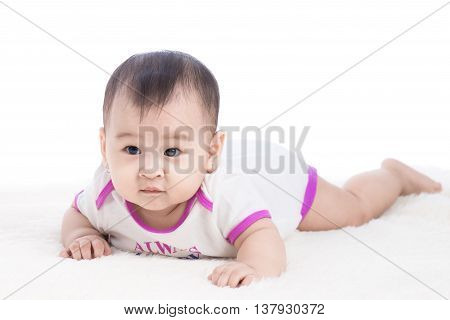 Funny baby girl crawling on whiter floor
