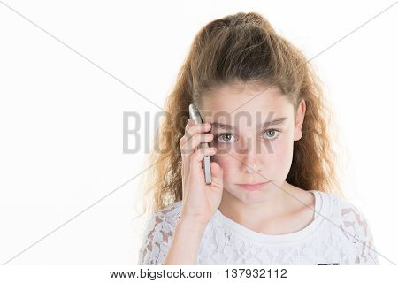 Little Girl Sad Talking On Mobile Phone, 10 Years.