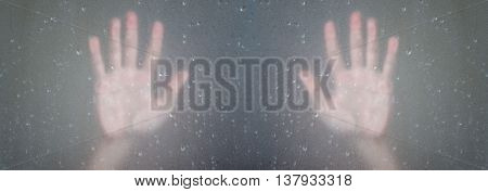 Palm hands behind frosted glass with droplets