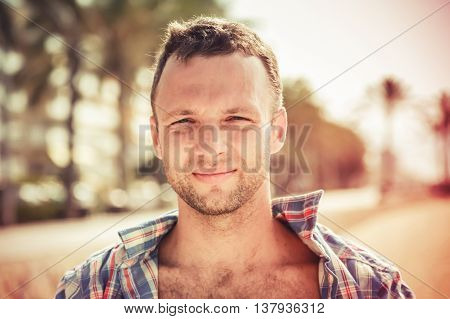 Smiling Young Handsome Caucasian Man In Summer