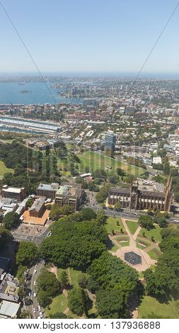 Sydney - February 25 2016: View of the city from the top of Sydney Tower visible and Hyde Park Archibald Fountain and St Mary's Cathedral February 25 2016 Sydney Australia