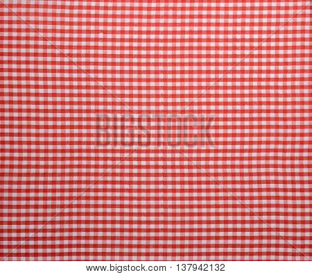It is red a white tablecloth close up.