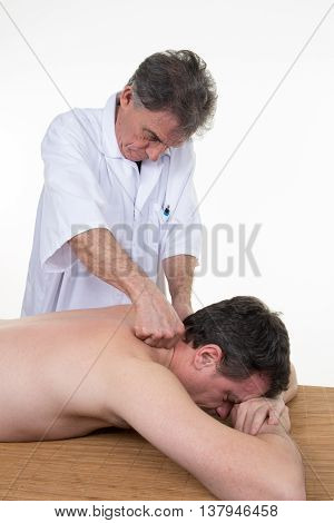 Man Having A Massage In A Wellness Center By Therapist