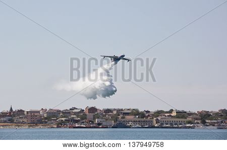 GELENDZHIK ,RUSSIA - SEPTEMBER 05, 2014: Multipurpose amphibian aircraft Be-200ES amphibious aircraft on the show flights