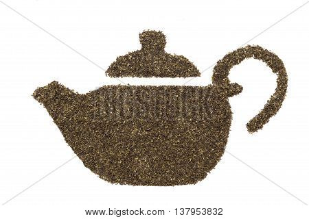Teapot shape made of organic tea bag cut Green Tea (Camellia sinensis) leaves. Isolated on white background. Top view.