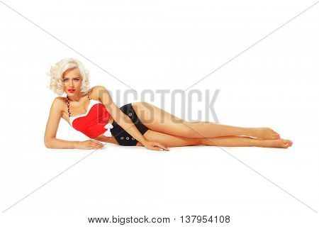 Young beautiful sexy tanned blonde woman in vintage bath costume lying over white background
