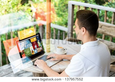 business, internet, media, people and technology concept - close up of businessman at laptop computer with news web page on screen outdoors on summer terrace and drinking coffee