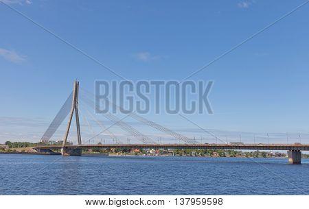 RIGA LATVIA - JUNE 7 2016: Vansu Bridge (1981 former Gorky Bridge) over Daugava River in Riga Latvia. One of five big bridges in Riga and the only cable-stayed
