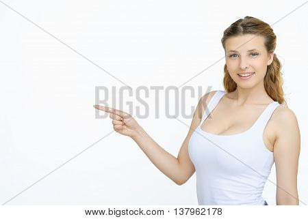 Advertising. Yound beautiful woman showing something. Girl pointing up on something. Woman pointing on copy space