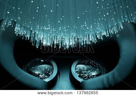 Black VR headset and Fiber optics background