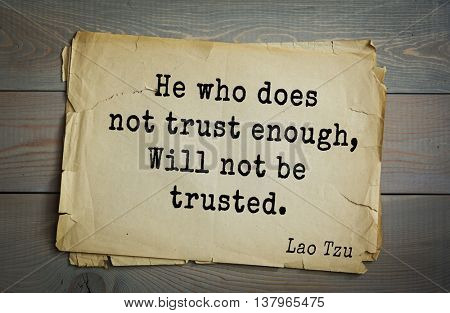 Ancient chinese philosopher Lao Tzu quote on old paper background.  He who does not trust enough, Will not be trusted.