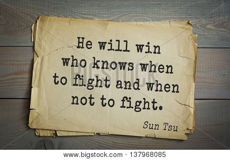 Ancient chinese strategist and philosopher Sun Tzu quote on old paper background. He will win who knows when to fight and when not to fight.