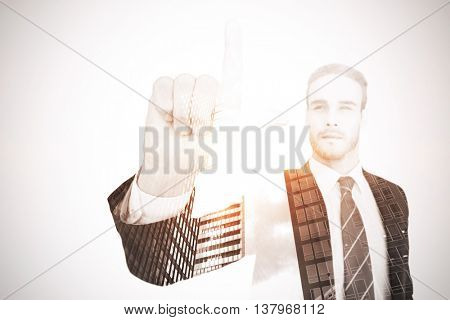 Unsmiling businessman in suit pointing up his finger