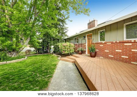 American Home With Patio Area, Also Grass Filled Lawn.
