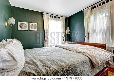 Small Bedroom With Wooden Bed, Dark Green Walls